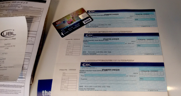 Pre-activated cheques and debit card issued to customer. PHOTO: UBL