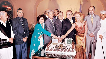 Ambassador Rodolfo and his wife, Susan, stand beside other guests during the cake-cutting ceremony at the reception hosted to celebrate Argentina's 200th year of independence. PHOTO: M. ALI