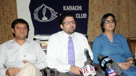 Dr Awab Alvi speaks at the Karachi Press Club conference.