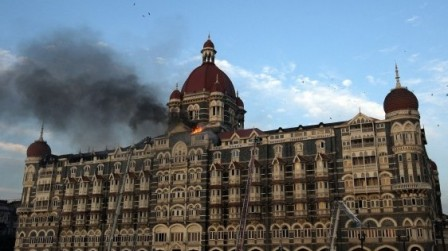 Flames rush out of the Taj Mahal Hotel in Mumbai, during an attack by suspected terrorists on November 7, 2008. PHOTO: AFP
