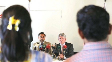 Andrew Mitchell addresses a conference in Islamabad on Thursday. PHOTO: ONLINE