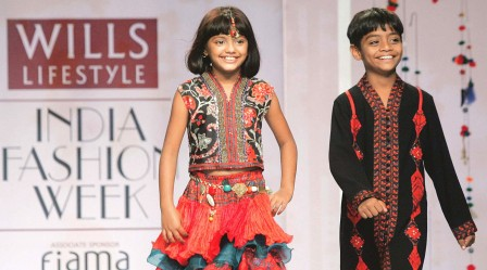 Slumdog Millionaire actors Rubina Ali and Azharuddin walk the runway at Wills India Fashion Week in 2009. PHOTO: EPA