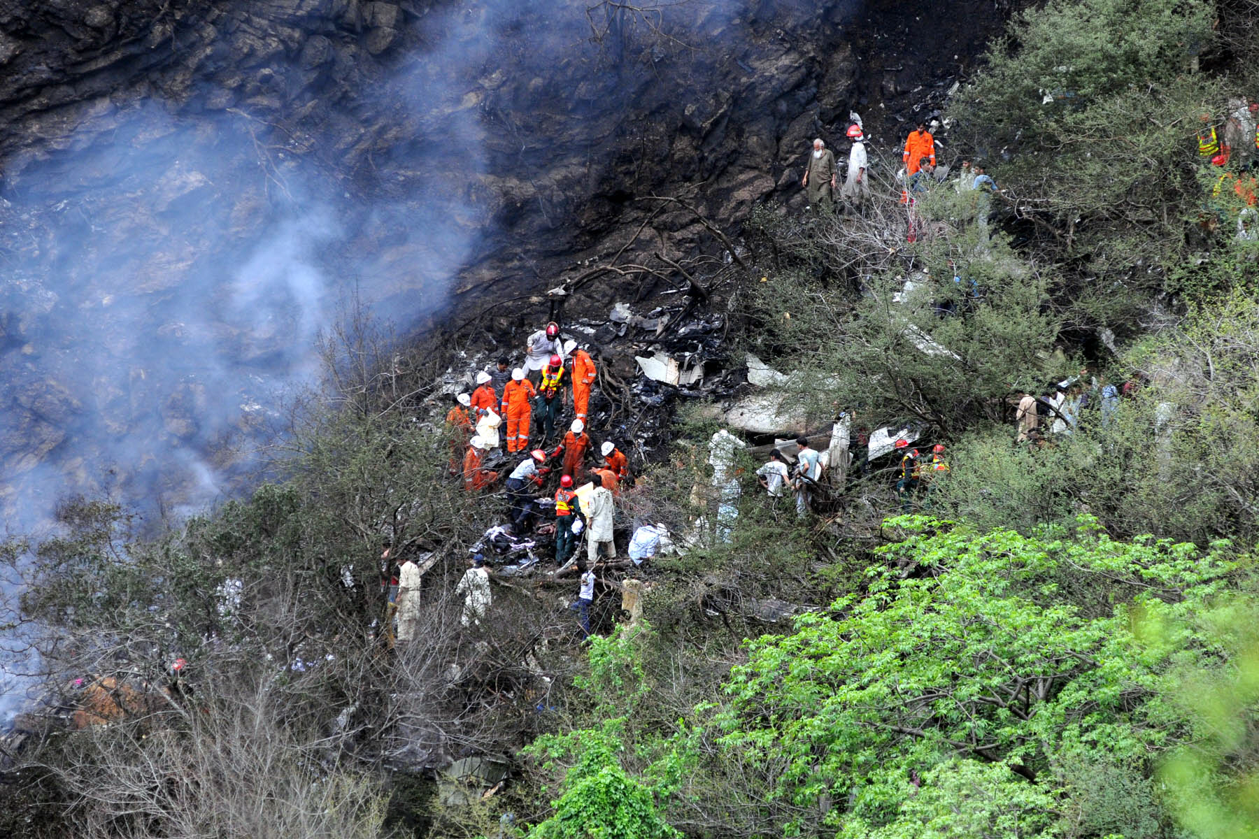 Rescue workers grow through the wreckage of the crash. PHOTO: QAZI USMAN