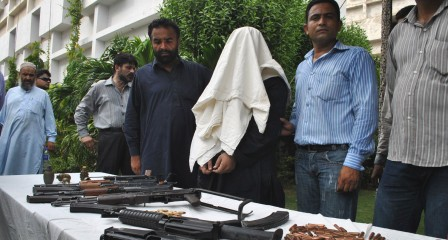 CID police also nab Lyari gangster, fear outbreak of turf war. PHOTO : MOHAMMAD NOMAN