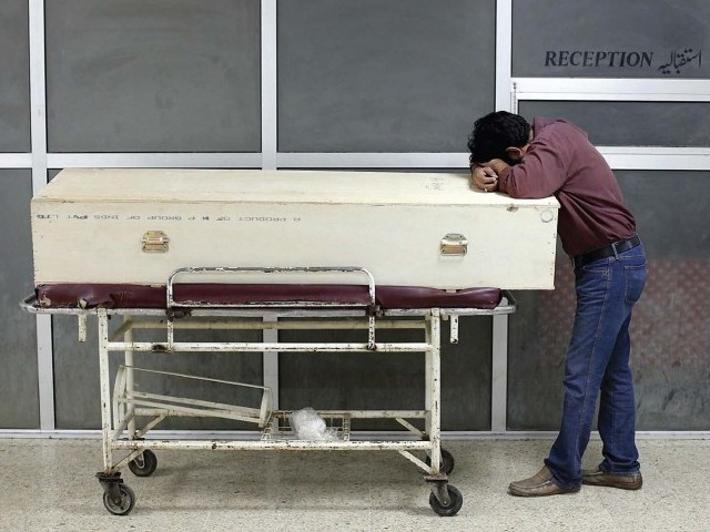 A youth mourns the death of a loved one killed in Wednesday's plane crash. PHOTO: REUTERS