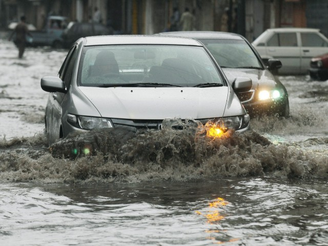 Traffic has been affected in several areas of Karachi due to heavy rainfall. PHOTO: AFP