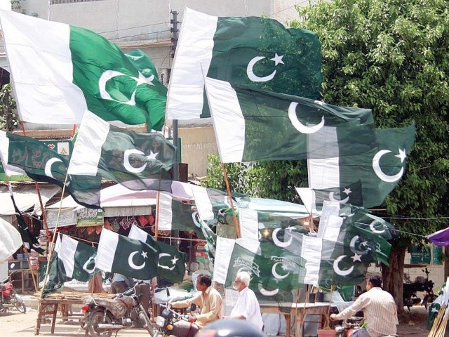 Flags being sold in Karachi for August 14. PHOTO: ONLINE
