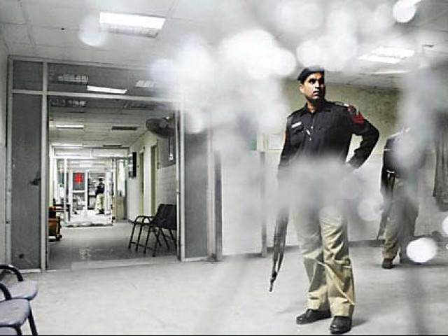 Police stand guard in Jinnah Hospital after the attack. PHOTO: FILE