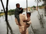 flood-man-children-afp