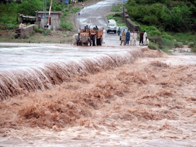 Flooding continues unabated in many areas. PHOTO: QAZI USMAN