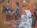 This September 23, 2010 courtroom drawing shows Dr Aafia Siddiqui with Judge Richard Berman. AFP PHOTO/SHIRLEY SHEPARD