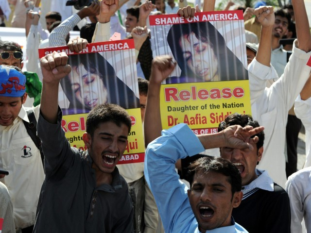 Protestors shout slogans as they march toward the US embassy during an anti-US protest in Islamabad. PHOTO: AFP