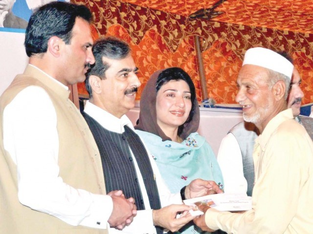 Prime Minister Yousaf Raza Gilani distributes Watan cards among people. Photo: NNI