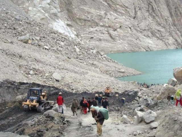 People shifting from a village submerged by the Attabad lake. PHOTO: FILE