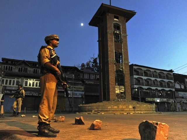 An Indian paramilitary soldiers stands guard in a curfew bound street in Srinagar. PHOTO: AFP