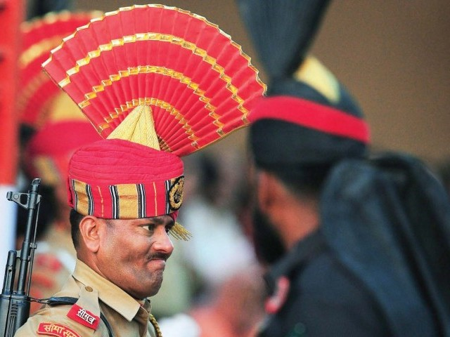 An Indian and a Pakistani border guard face off during the ceremony. PHOTO: FILE