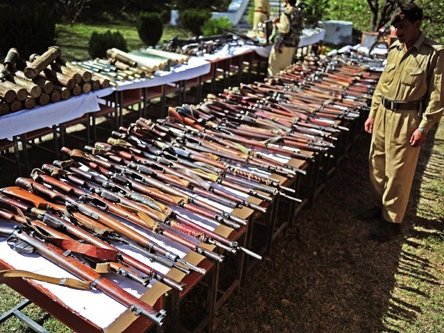 Rifles seized from insurgents in the Orakzai tribal agency displayed at Kalaya military base on October 26, 2010. PHOTO: AFP