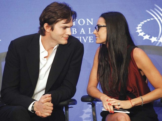 Ashton Kutcher and Demi Moore tweet each other while sitting in the same house. PHOTO:REUTERS