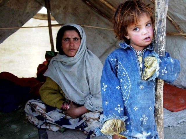 Pakistan is home to 1.7 million Afghan refugees -- 1.5 million of whom live  in areas affected by the country's worst humanitarian disaster. PHOTO: EPA