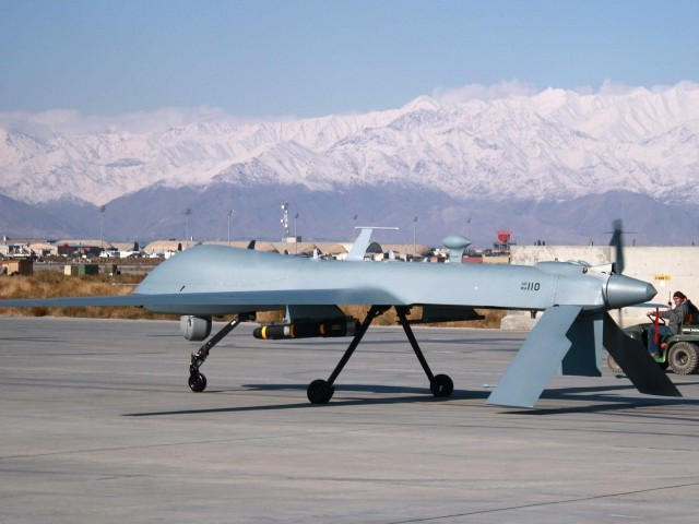 This file photo taken on November 27, 2009 shows a US Predator unmanned drone armed with a missile setting off from its hangar at Bagram air base in Afghanistan. PHOTO: AFP