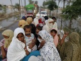 flood-victims-travel-atop-a-truck-over-a-flood-affected-area-in-pakistans-muzaffargarh-district-of-punjab-province-2-2