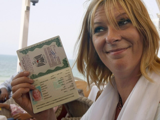 Lauren Booth holding the VIP Palestinian passport she received during her stay in the Gaza Strip along with other pro-Palestinian activists. PHOTO: AFP
