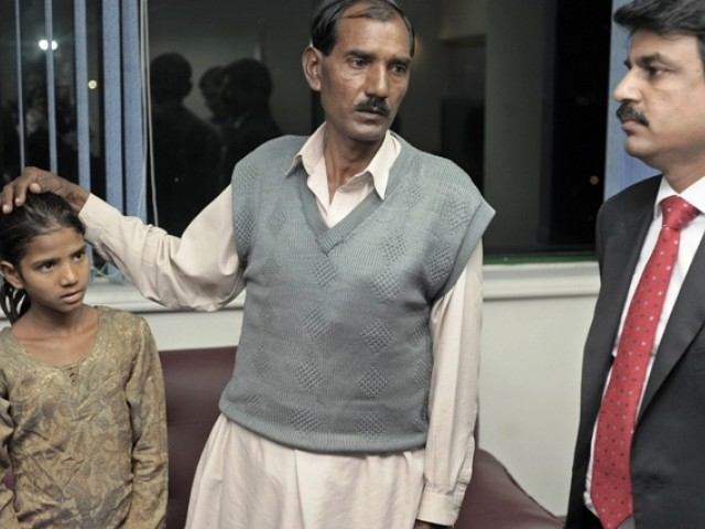 Ashiq Maseeh, husband of Aasia Bibi, talks with Minister of Minority Affairs Shahbaz Bhatti in Islamabad. PHOTO: AFP