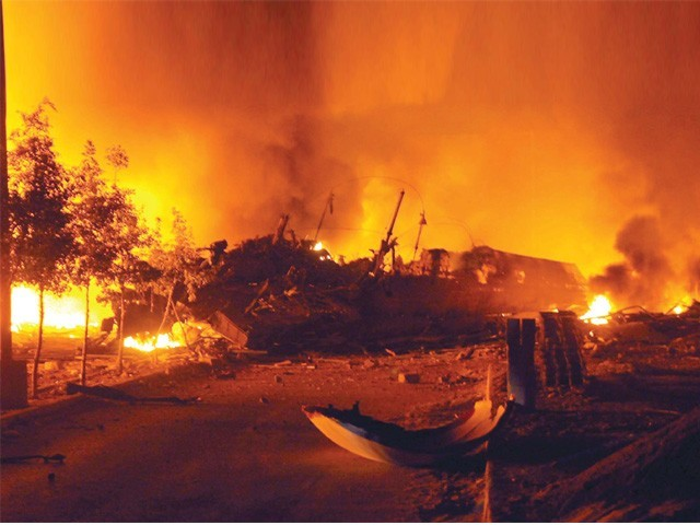 The crashed plane's debris in the foreground as fire from burning jet fuel engulfs the area. PHOTO: MUHAMMAD ADEEL/EXPRESS