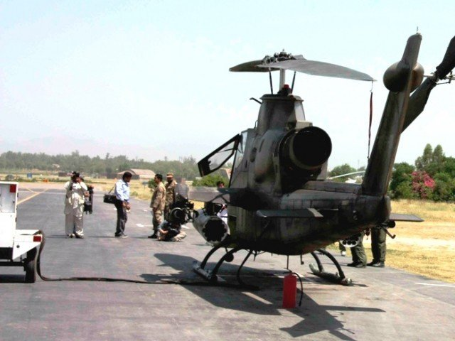 Pakistani Army gunship helicoptersat a military base in Peshawar, the capital of militancy-hit North West Frontier Province (NWFP), during a break in an operation against Taliban militants in Swat valley, on 27 May 2009. PHOTO: EPA
