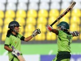 The Pakistan opening pair Javeria Wadood (L) and Nida Rashid (R) celebrate victory over Bangladesh in the women's limited overs cricket gold medal final 16th Asian Games. PHOTO: AFP