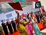 school-children-dance-with-pakistani-and-chinese-flags-in-front-of-their-leaders-during-the-inauguration-ceremony-of-the-pakistan-china-friendship-center-in-islamabad-december-18-2010-china-and-paki