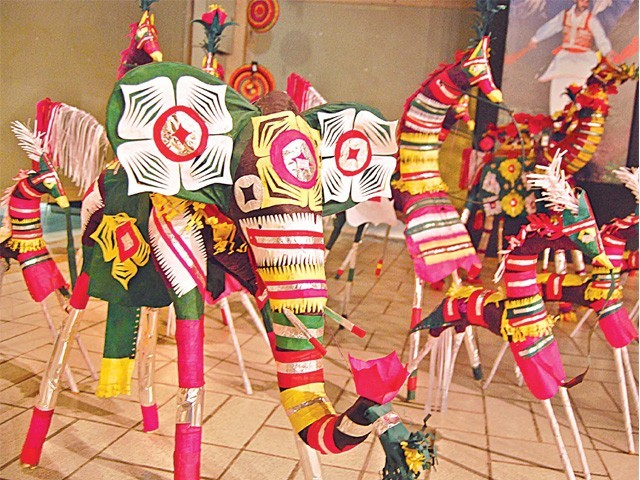 Tradition toys made from clay, cane and colourful papers are displayed at a crafts exhibition at Lok Virsa on Wednesday. PHOTO: MUHAMMAD JAVAID