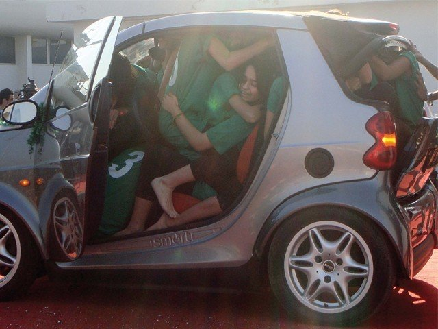 Nineteen A' level students fit into one car to set a world record at DHA Creek Club on Wednesday. PHOTO: HASSAAN KHAN/EXPRESS