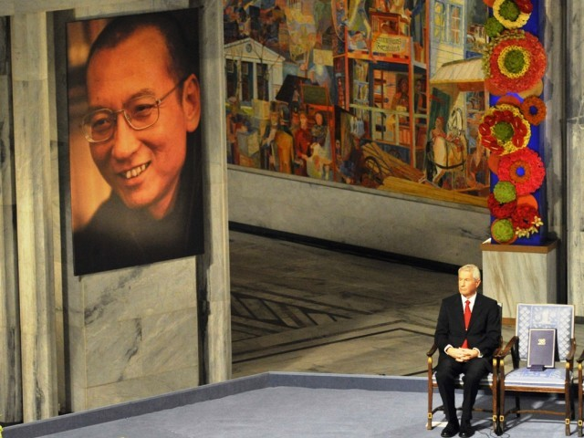 Nobel Committee chairman Thorbjorn Jagland sits next to the empty chair where Nobel Peace Prize winner Liu Xiaobo should sit during the Nobel Peace Prize ceremony in Oslo. PHOTO: REUTERS
