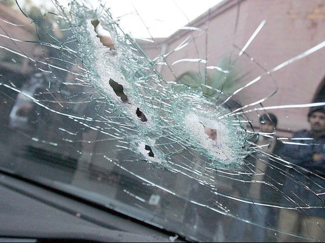 Broken windshield of the US diplomat's car after he fired at two people in Lahore. PHOTO: IJAZ MAHMOOD