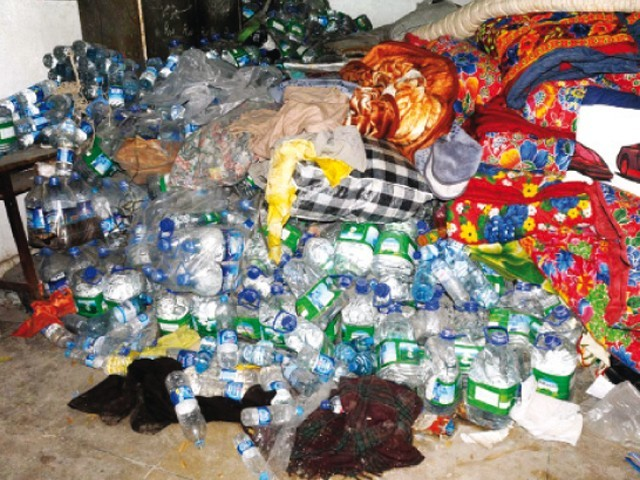Goods donated for the flood-hit populace were left to rot. PHOTO: WASEEM IMRAN