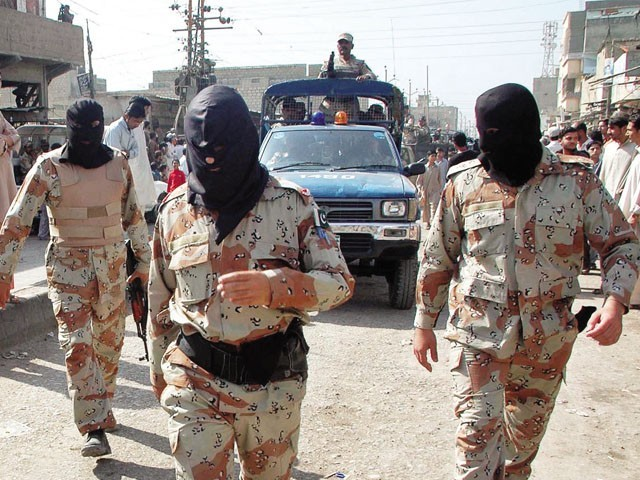 Rangers personnel wore black masks to protect their identities. PHOTO: ONLINE
