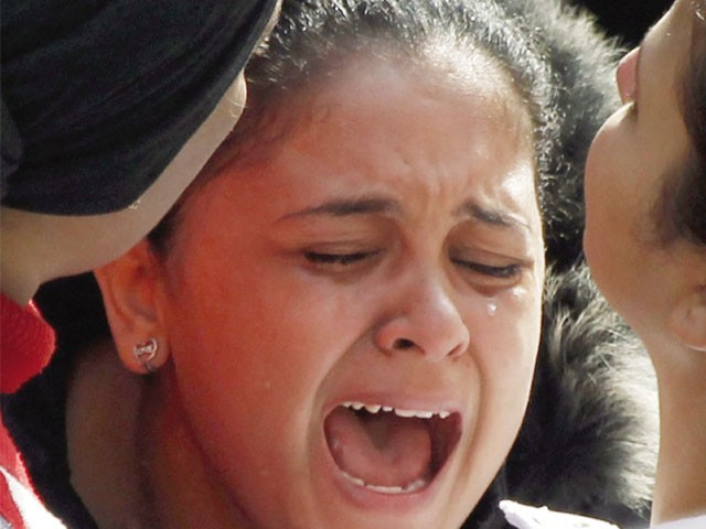 An Egyptian girl cries after a suicide attack killed at least 21 outside the Coptic Orthodox church in Alexandria. PHOTO: REUTERS
