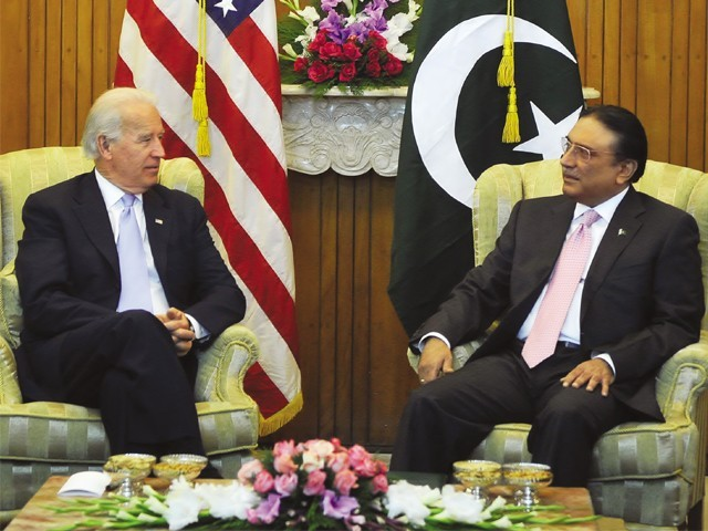 US Vice President Joe Biden talks to President Asif Ali Zardari at the President House in Islamabad. PHOTO: AFP