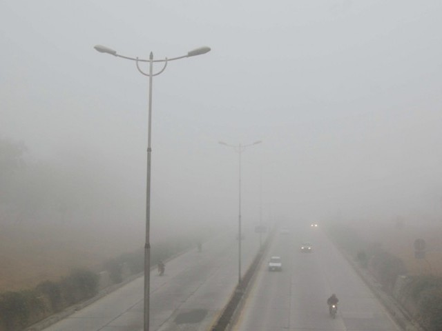 A view of fog covered the skies of federal capital as well as twin city Rawalpindi on Monday. Express Tribune Photo/Muhammad Javaid