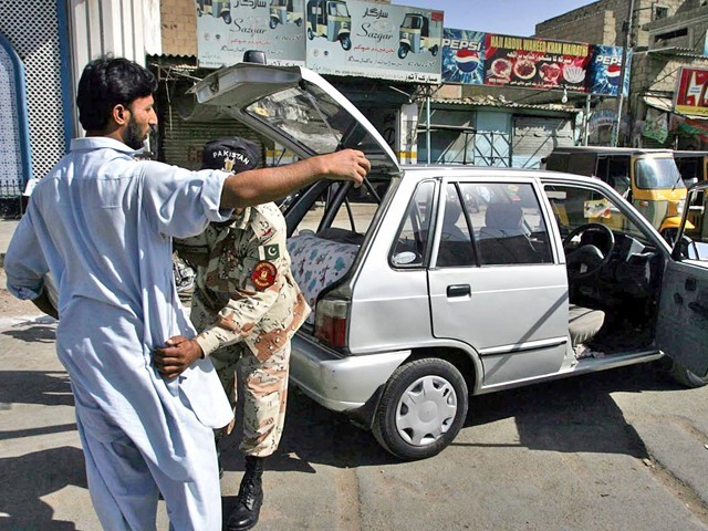 A Ranger frisks a car driver as security is beefed up in the city following a fresh wave of target killings. PHOTO: ONLINE
