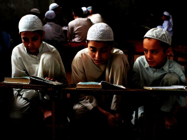 Afghan govt setting up Islamic seminaries to attract students going to Pakistan, K-P govt reforming syllabus. PHOTO: EPA/FILE