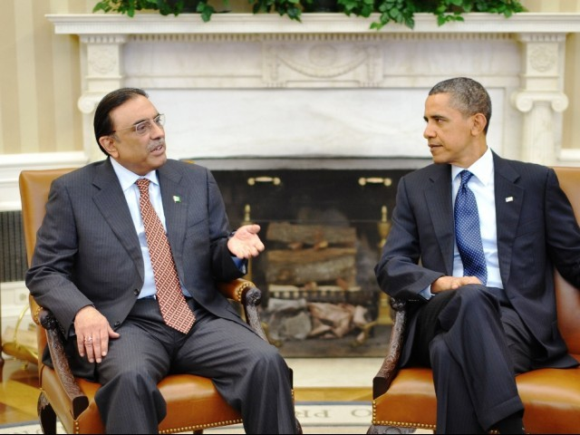 Pakistan President Asif Ali Zardari (L) speaks at a meeting with US President Barack Obama January 14, 2010 in the Oval Office of the White House in Washington. PHOTO: AFP