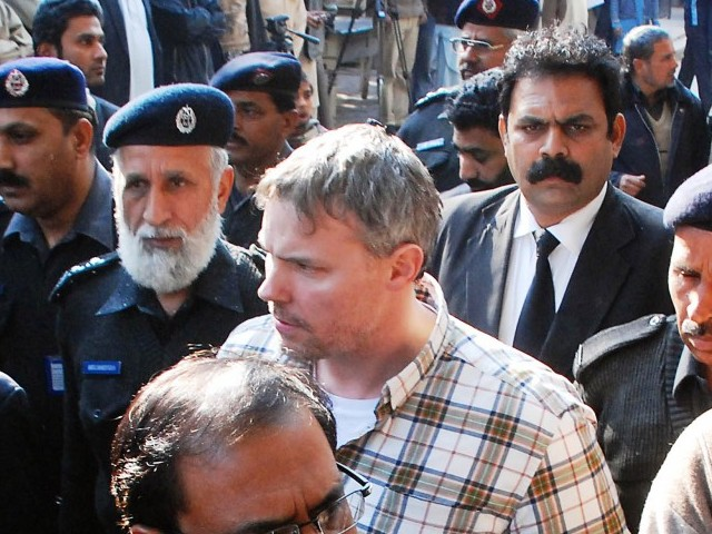 Pakistani police escort arrested US national Raymond Davis (C) to a court in Lahore. PHOTO: AFP
