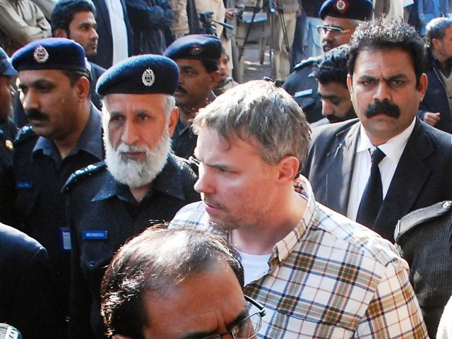 Pakistani police escort arrested US national Raymond Davis (C) to a court in Lahore. PHOTO: AFP/FILE