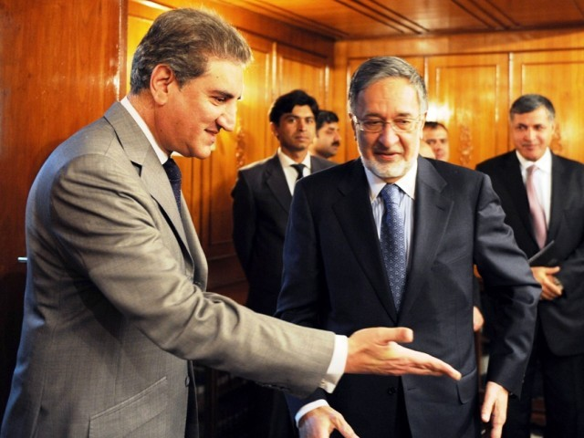 Foreign Minister Shah Mehmood Qureshi (L) gestures as he arrives for a meeting with his Afghan counterpart Zalmai Rassoul at the Foreign Ministry in Islamabad. PHOTO: AFP