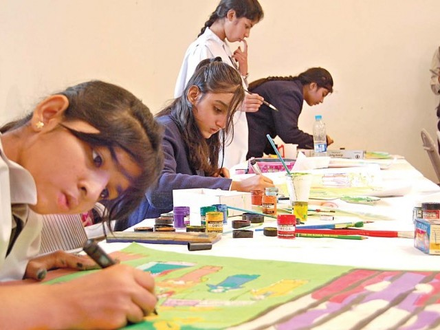 students working on their art pieces at a painting competition organized by the pakistan national council - Children Painting Images