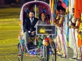 Pakistan cricket captain Shahid Afridi arrives in a cycle rickshaw during the opening ceremony of the Cricket World Cup at Bangabandhu stadium in Dhaka on February 17, 2011. PHOTO: AFP