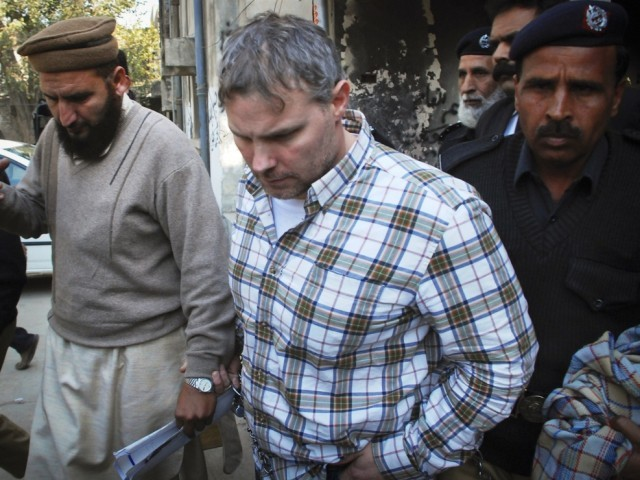 Raymond Davis is escorted by police and officials out of court after facing a judge in Lahore January 28, 2011. Davis, held in Pakistan on double murder charges for a shooting in Lahore last month, is employed by the CIA as a contractor, U.S. sources closely following the case said.
