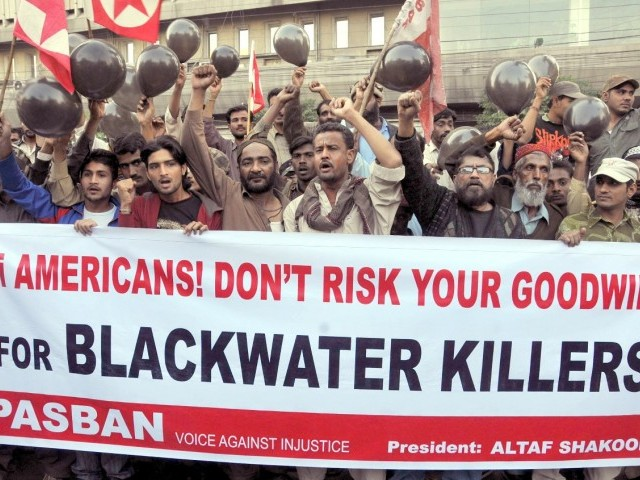 People in Karachi protest against the killing of three Pakistanis by an American citizen, Raymond Davis, on February 1. PHOTO: EXPRESS